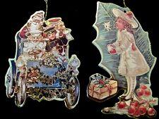 "2 Vintage Victorian Christmas Scene Die Cut Cardboard Ornaments Signed ""Oilette"""