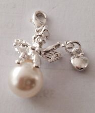 SILVER ANGEL HOLDING A SILVER HEART ON A PEARL CLIP ON CHARM -  SILVER PLATE