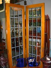 PAIR OF BEVELED LEADED GLASS FRENCH DOORS IN OAK