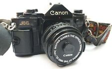 CANON A-1 35mm SLR with 50mm f1.8 Lens + Flash + power winder + 2 additional len