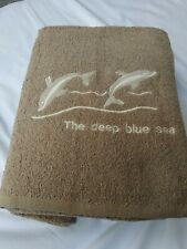Set Of 4 Hand And Bath Towels. Brown
