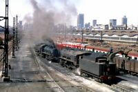 PHOTO  SOUTH AFRICAN RAILWAYS - BRAAMFONTEIN SHED LOCOS  BOTH 0-8-0S AN S AND AN