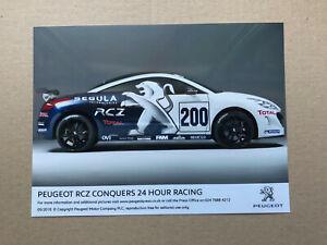 2010 'Peugeot RCZ Conquers 24 Hour Racing' Press Photograph