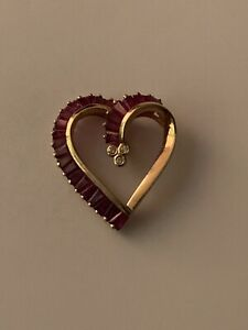A 14 carat gold ruby and diamond heart pendant