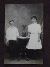 CHILDREN WITH SMALL DOG ON TABLE Vtg REAL PHOTO POSTCARD
