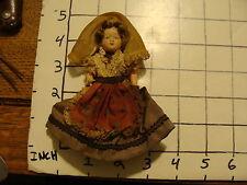 Original Vintage religious girl, with large cross around neck, plastic