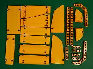 21 New Genuine Bright light orange Lego Technic beams, panels liftarms
