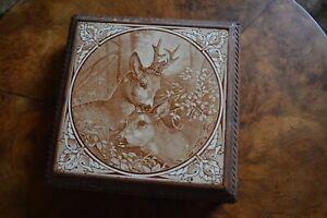 French Art Deco ceramic reindeer on oak wooden trivet stand