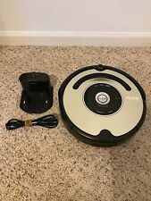 iRobot 560 Roomba Vacuuming Robot BLACK AND SILVER