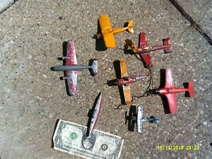 Six TootsieToy and other small Toy Airplanes. Varying condition Free Sub