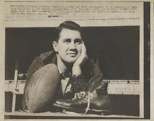 REPRINT OF VINTAGE IMAGE OF PAT SOMERALL, LOST IN THOUGHT WITH A FOOTBALL. 8x10