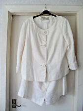 Size 22  Ivory coloured skirt suit + textured material=wedding?
