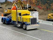 "1/64 DCP CUSTOM YELLOW/BLUE PETERBILT 389 W/ 63"" SLEEPER"