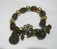 Great bronze tone metal bracelet elasticated with plastic beads and metal charms