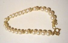 Avon presents a genuine freshwater pearl bracelet with clear crystal spacer bead