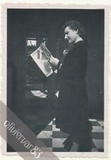 Woman reading Marie Claire magazine in mirror reflection - vintage photo