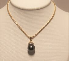 Brand new black Tahitian Pearl Pendant set in 14k solid yellow gold.