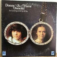 DONNY  &  MARIE  OSMOND           LP     I,M  LEAVING  IT  ALL  UP  TO  YOU