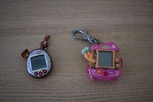 2 x Tamagotchi Electronic Pets  Hasbro Littlest Pet Shop and Bandai