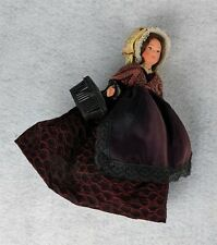Vintage Plastic Doll in Brown and Black Dress Carrying Basket 9""