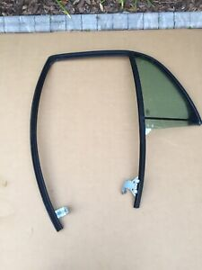 03-11 Mercury Grand Marquis Rear Driver Side Door Vent Glass With Frame OEM