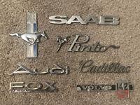 Vintage Lot of 7 Auto Emblems Cars Pinto, Ford Mustang, Audi, Cadillac, Saab...