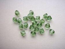 30 Swarovski® Kristall Perlen Xilion Beads 4mm PERIDOT Art. 5328