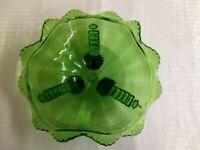 Detailed Victorian ? patterned ruffled footed green glass candy dish.