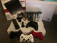Sony PlayStation 3 Bundle with 4 Controllers and 14 Games and Accessories