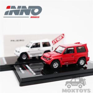 INNO 1:64 MITSUBISHI PAJERO EVO With Extra Wheels White/Red Model Car