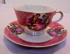 "Cup & Saucer, Luster Colonial Couple, Saucer 5.5"" Across Cup 3.5"" Top 2.25"" Tall"