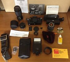 Canon A-1 35mm SLR Film Camera AB-56 Flash Auto-Winder 3 Lenses 2 Filters Cases