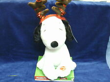 Snoopy Moves his head and antlers wiggle /plays peanuts theme song