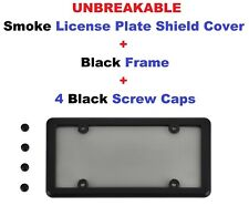Black Frame + UNBREAKABLE Smoke License Plate Shield + 4 Screw Caps for Vehicles