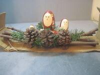 CHRISTMAS AROUND THE WORLD NESTING SANTA CENTERPIECE