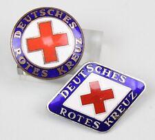 """Zwei emaillierte Abzeichen """"Deutsches Rotes Kreuz"""""""