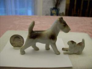 VINTAGE 2 MINIATURE PORCELAIN MOMA  AIREDALE TERRIER DOG PLAYFUL PUPPY FIGURINES