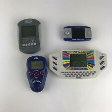 handheld electronic game lot. 4 Games