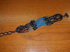 Native American Beaded Bracelet 10 Strands Shades of Blue and Purplish Rainbow