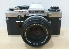 Olympus OM-10 35mm SLR Film Camera with 50 mm lens excellent condition.