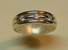 14K 2 tone gold band with 3 diamonds
