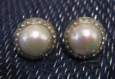 Very pretty silver tone metal earrings white stones surround faux pearl bead