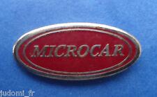 Pin's pin LOGO MICROCAR VOITURE SANS PERMIS (ref H35)