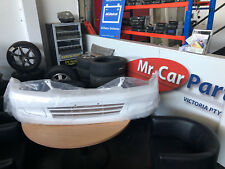 FORD LASER KN ONLY 01/99- 01/01   FULL RECONDITIONED FRONT BAR COVER