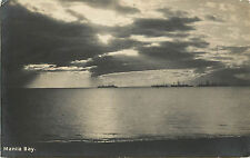 Rppc Postcard Manila Bay With Ship silhouette in Distance Postmarked Philippines