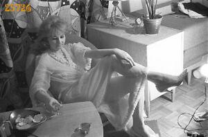 woman drinking vodka, strange light, stiletto shoes 1970s vintage negative!
