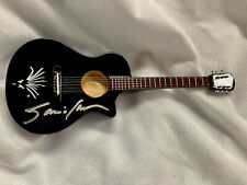 Janis Ian Rude Girl mini guitar (black) signed by Janis RARE