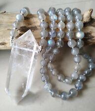 Large Clear quartz crystal pendant on labradorite bead necklace.
