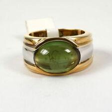 Anillos de joyería con gemas verdes sin tratar