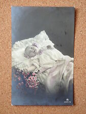 R&L Postcard: Studio Portrait of Baby in Crib/Bed/Cot, Color Tinted 1913 Carlton